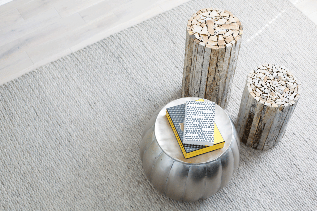 Cassidy-Hughes-Interior-Design---Contemporary-Grey-Carpet-with-Wooden-Stools