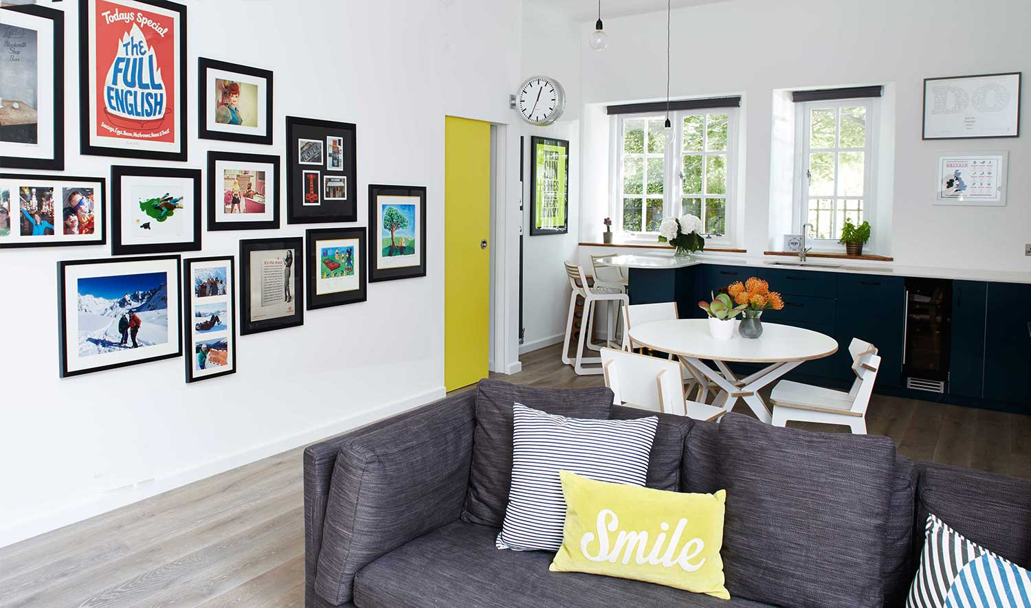 Cassidy_Hughes_Design_Living_Gallery_Wall_Yellow_Pocket_Door_Open_Plan