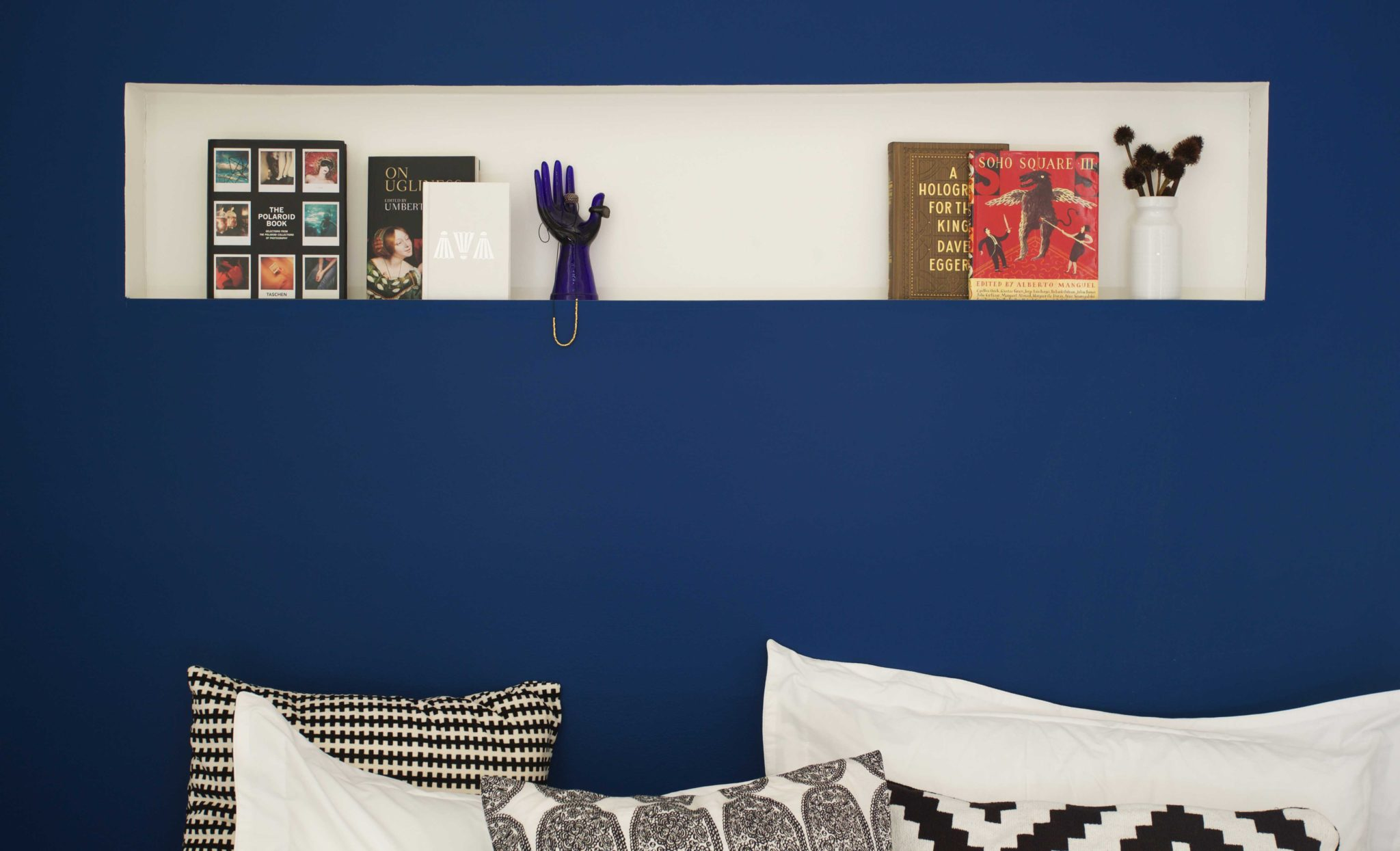 12. Cassidy_Hughes_Design_Niche_Face_Out_Books_Bed_Blue_Wall